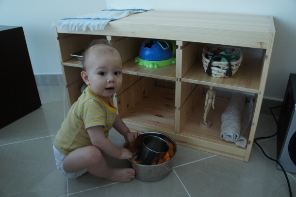Retrieving materials from his cabinet